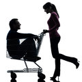 Couple woman with man sitting in shopping cart silhouette one caucasian women men studio isolated on white background Stock Images
