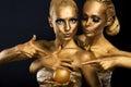 Couple women golden body art glamor Royalty Free Stock Images