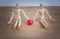 A couple of wooden doll man on valentine days showing love to each other Royalty Free Stock Photo