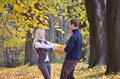 Couple in the woods loving autumn forest with yellow leaves Stock Photography