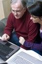Couple working on laptops Royalty Free Stock Photo