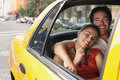 Couple In Yellow Taxi Royalty Free Stock Photo