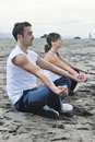 Couple yoga beach Royalty Free Stock Photo