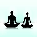 Couple of yogi man and woman are sitting in meditation pose Stock Image