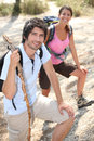 Couple of young hikers by the sea Royalty Free Stock Photos