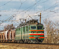 The coupled locomotive VL80-605 pulls freight cars of freight tr