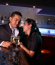 Couples au bar avec le champagne Photo libre de droits