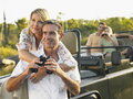 Couples with binoculars in jeep two happy on trip Royalty Free Stock Photos