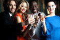 Couples enjoying champagne or wine at a party friends in Royalty Free Stock Photo