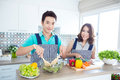 Couples in kitchen young happy domestic Stock Image