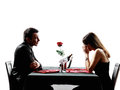 Couples lovers dating dinner dispute separation silhouettes dinning in on white background Royalty Free Stock Image