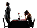 Couples lovers dating dinner dispute separation silhouettes dinning in on white background Stock Photos