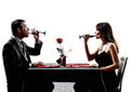 Couples lovers drinking wine dinner silhouettes dinning in on white background Stock Photo