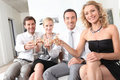 Couples sitting holding champagne glasses Royalty Free Stock Photography