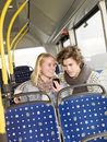 Couples sur le bus Photo stock