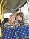 Couples sur le bus Photographie stock libre de droits