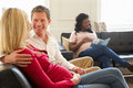 Couples in waiting room of ante natal clinic sitting down relaxing Stock Images