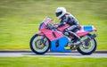 Coureur féminin sur la motocyclette Image libre de droits