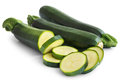 Courgettes whole and sliced isolated on white. Royalty Free Stock Photo