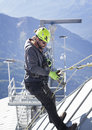 COURMAYEUR, ITALY - JULY 29, 2016:Young eager climber practicing before going up to Mount Blanc Royalty Free Stock Photo