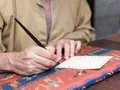 Court clerk with pen in hand writing on parchment Stock Images
