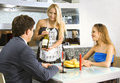 Courting couple and waitress Royalty Free Stock Photos