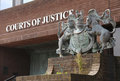 Courts of justice portsmouth england april overgrown red brick plinth with royal crest Royalty Free Stock Photos
