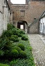 Courtyard garden at 15th century Jerusalem Church Jeruzalemkerk, Bruges / Brugge, Belgium. Royalty Free Stock Photo