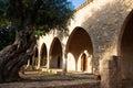Courtyard of the monastery tree in ayia napa sun shining upon arches Royalty Free Stock Photos