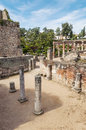 Courtyard with remains of columns the ancient roman civilization was in spain in merida is a vertical image in the Stock Photo