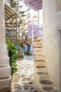 A courtyard snamll in the centre of mykonos greece with steps leading to apartments Royalty Free Stock Photography