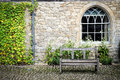 Courtyard a wooden bench in a with cobbled stones Royalty Free Stock Image