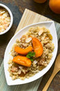 Couscous and apricot dessert with apricots yellow raisins coconut flakes cinnamon served on plate garnished with lemon balm leaf Stock Photography
