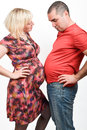 Couvade syndrome sympathetic pregnancy a husband is experiencing or Royalty Free Stock Image