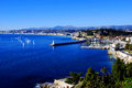 Cove of nice with floating yachts blue sea in the bay on the background the city and mountains Stock Photography