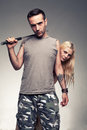 Cover young man with a metal baton protecting his girlfriend Stock Photos