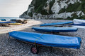 Covered boats on a shingle beach Stock Image