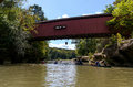 Covered bridge over sugar creek a spans in marshall indiana home of turkey run state park where people fish canoe swim hike and Royalty Free Stock Images