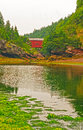 Covered bridge over a tidal stream the wolfe point creek in fundy national park Stock Image