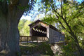 Covered bridge thornapple over river in ada township michigan Royalty Free Stock Photo