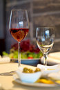 Covered dining table with wi a wine glasses Royalty Free Stock Photo