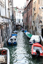 Covered gondolas on on a venetian Canal, Venice, Italy Royalty Free Stock Photo