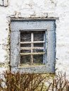 The window of an old whitewashed barn of a manor house in Weweler, Belgium Royalty Free Stock Photo