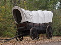 Covered wagon and autumn leaves in early fall Stock Photo