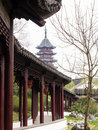 Covered walkway and pagoda in classical Chinese garden Royalty Free Stock Photo