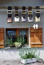 Cow bells under window Royalty Free Stock Photo
