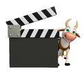 Cow cartoon character with clapper board Royalty Free Stock Photo
