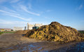 Cow manure on pile on farmland Royalty Free Stock Image