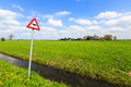 Cow warning sign in a dutch landscape Royalty Free Stock Photo