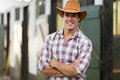Cowboy arms crossed good looking with in stable Stock Photos